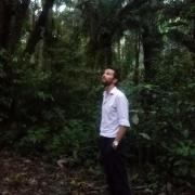 Peter Newton in the Amazonian state of Acre, Brazil looking up
