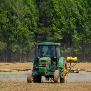 An agricultural field is sprayed with fertilizer or pesticides. (Credit: John Lambeth / Pexels)