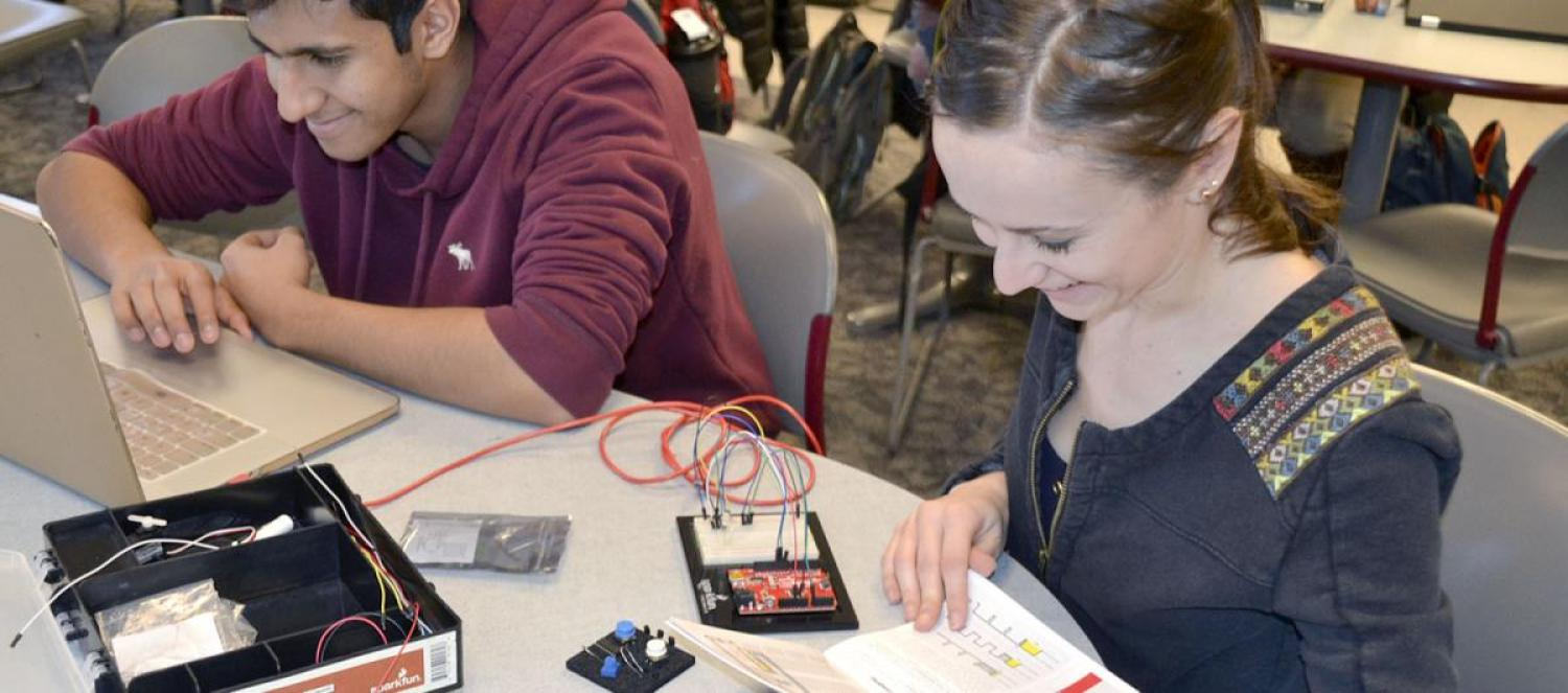 Students working on circuits during class