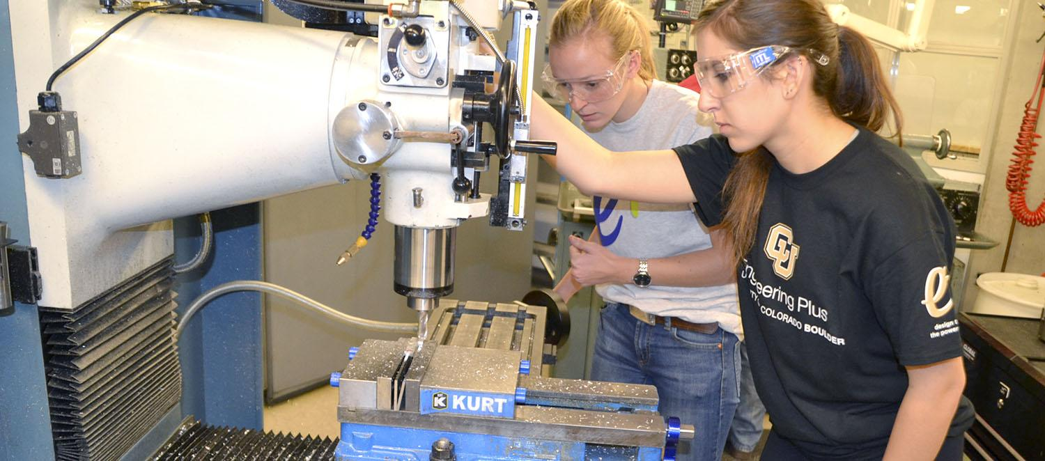 Students using machinery in the Integrated Teaching and Learning Laboratory.