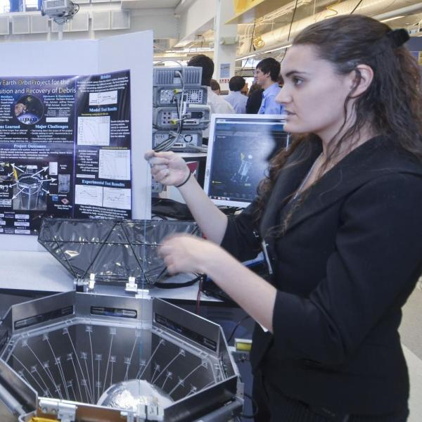 Student presenting project during ITLL Design Expo.