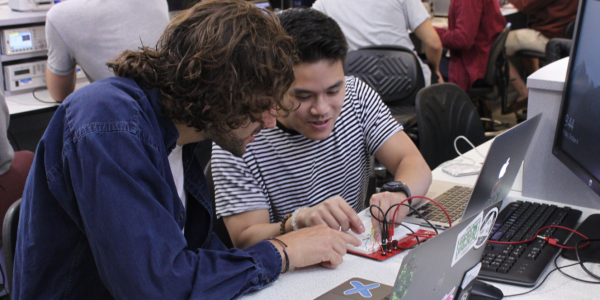 Students working on a circuit in Circuits for Engineers