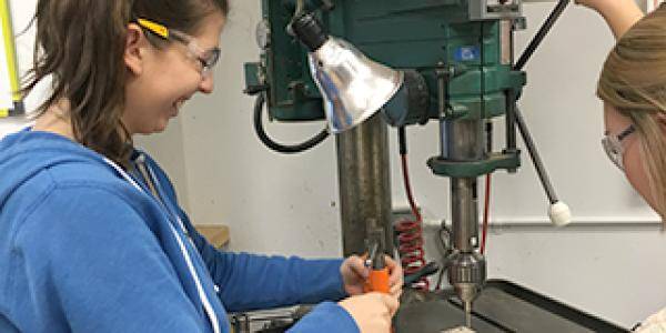 Students use machinery during design courses in the ITLL.