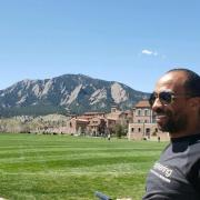 Adviser Barrow in front of the flatirons