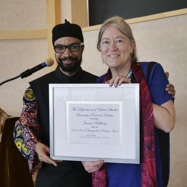 Dr. Joanne Belknap receiving the Chair's Distinguished Teaching Award from Dr. Reiland Rabaka
