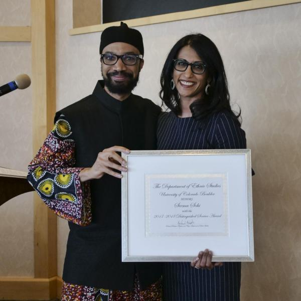 Dr. Seema Sohi recieving the Chair's Distinguished Service Award from Dr. Reiland Rabaka