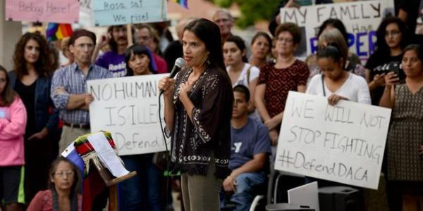 University of Colorado Law Professor Violeta Chapin speaks during a DACA rally