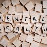 "scrabble tiles spelling the words ""mental health"""