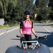 Sara Beck with her bike on the Tour de France route