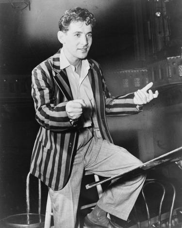 Bernstein on a stool conducting