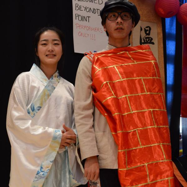 Two Japanese students dressed in their traditional attire.