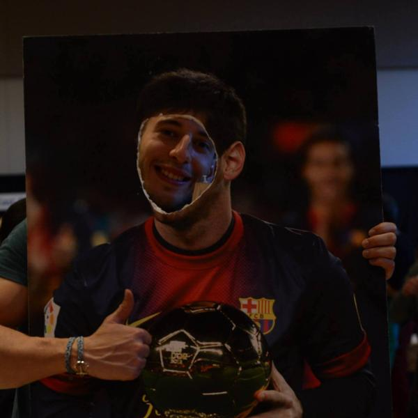 Lionel Messi's face cut picture at Catalonian booth.