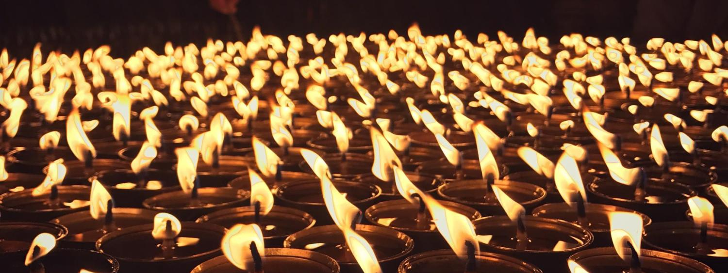 Butter lamps offered at the Bodhnath Stupa in Nepal