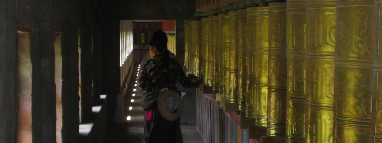 Spinning prayer wheels at Peyul Tharthang