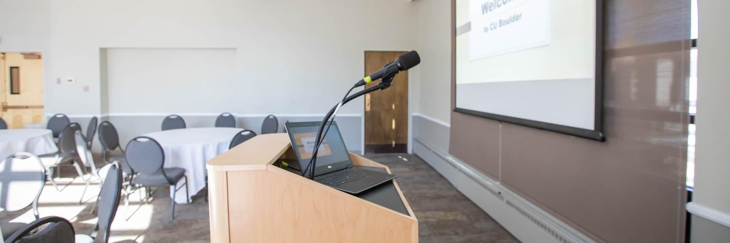 Podium with laptop and microphone set-up