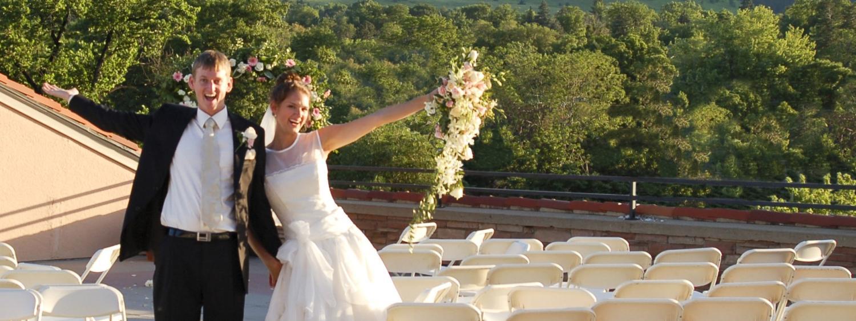 Wedding couple posing on UMC rooftop balcony