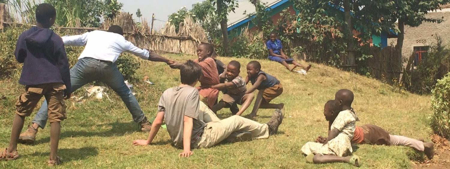 Playing tug-of-war with children