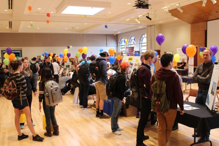 Students visit tables at the Off-Campus Housing Fair