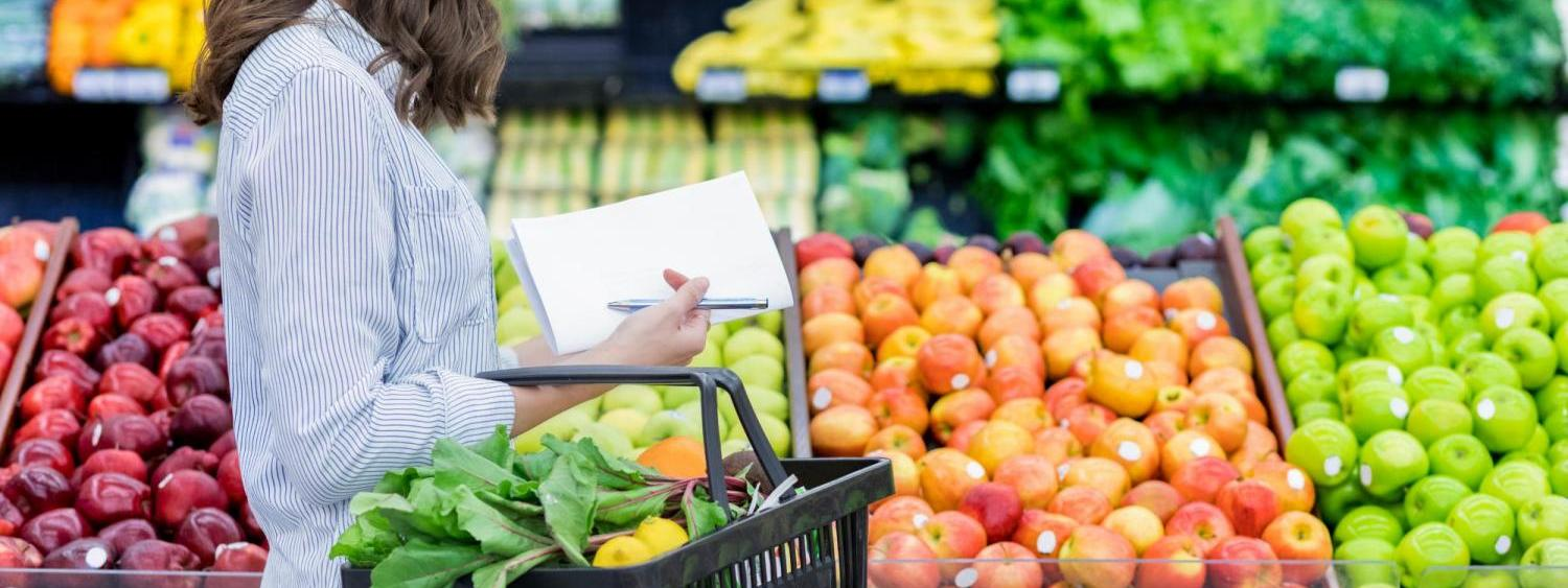 Person shopping for fruits and vegetables.