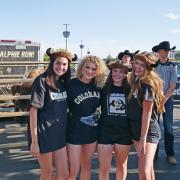 Students in Buffs gear pose for photo with Ralphie at the Rocky Mountain Showdown
