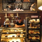 Employee ready to take orders at The Bakery in the C4C