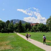 Students walking on CU Boulder campus.