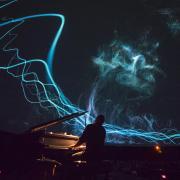 Pianist plays during Fiske Planetarium light show