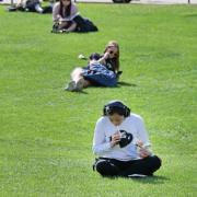 Students relax on the physics lawn between classes