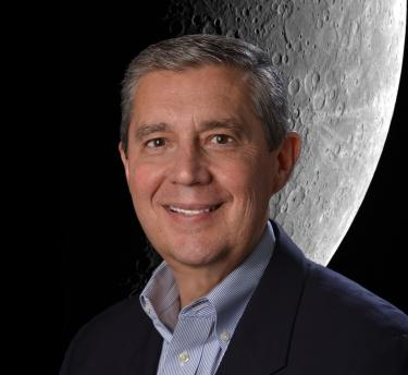 Dr. Jack Burns with Moon image behind him