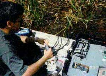 ravichandran collecting surface water samples