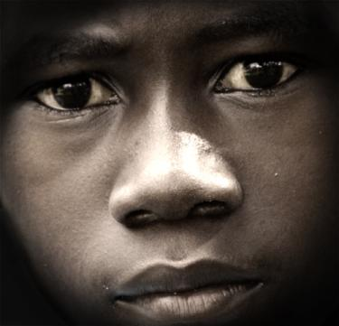 The face of a young boy from Uganda named Wasswa
