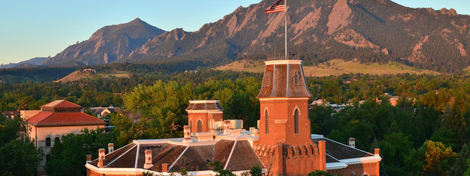 Old Main building in front of the Flatiron mountains