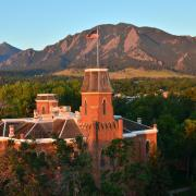 Old Main on the CU Boulder Campus with the Flatirons behind
