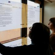 Participants of CU's Financial Futures initiative read over proposed solutions in UMC room 425.