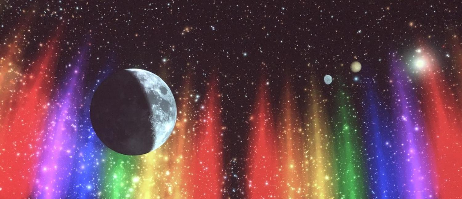 Interior of Fiske Planetarium with the moon on the dome and rainbow lights