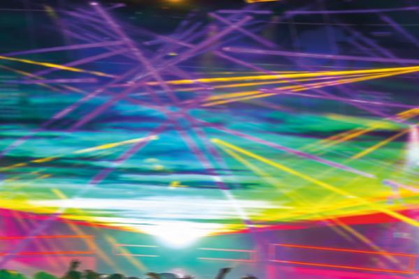 Distorted photo of lasers at an EDM show