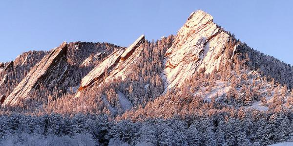 Flatirons in snow at sunrise