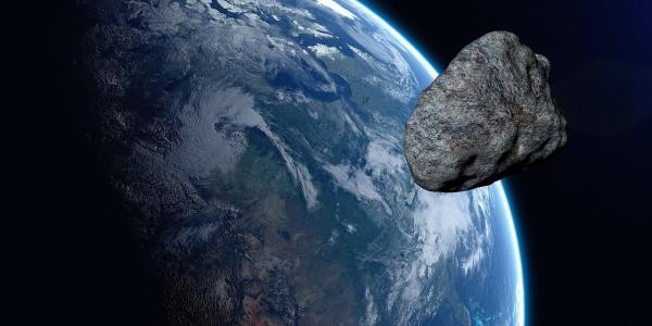 Artist illustration of an asteroid flying by Earth