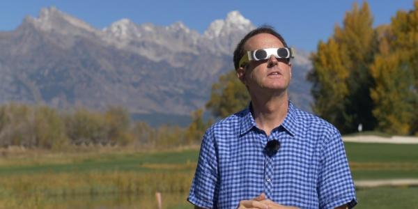 Doug with eclipse glasses