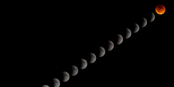Astrophotograph of a sequence of lunar photos moving into a total lunar eclipse