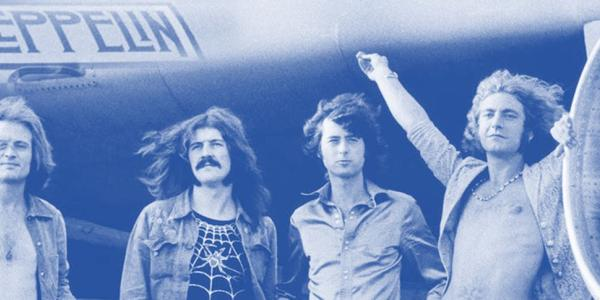 Led Zeppelin band photo in front of airplane