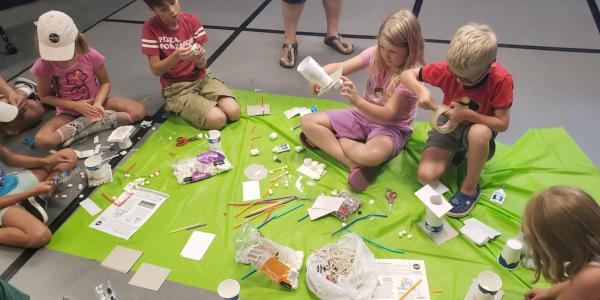 Group of kids at Fiske building lunar landers.