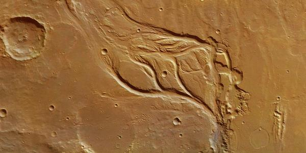 Photo of the surface of Mars with a valley