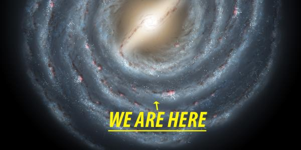 "Artist's conception of the Milky Way and the location of our solar system. Text reads, ""We are Here."""