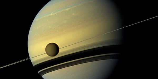 Picture of Saturn with rings and the moon Titan from NASA.