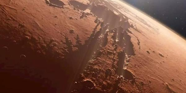 Artist illustration of flying over a canyon on Mars