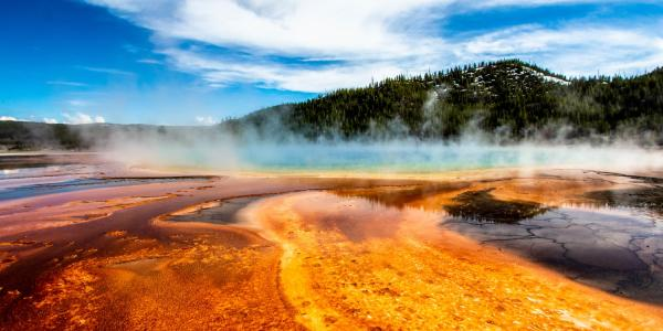 Photo of a mountain and a geyser in Yellowstone