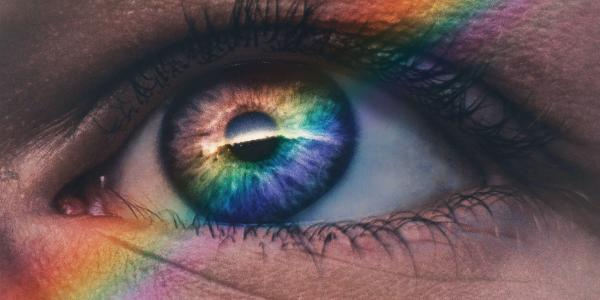 Rainbows in our Universe photo of human eye with rainbow across the iris