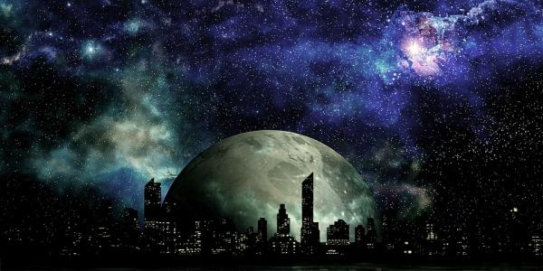 Futuristic scene of city with moon in the background
