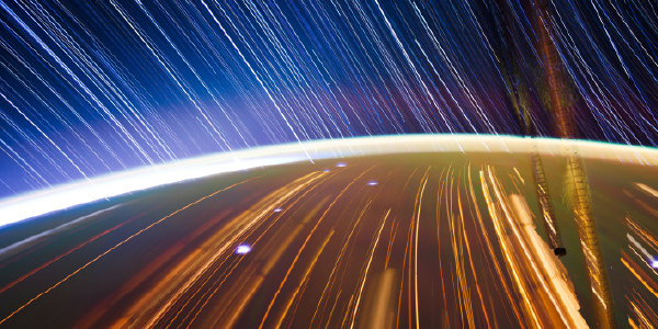 Artist picture of the ISS orbiting the Earth at a high speed